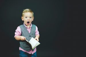 Excited child holding book